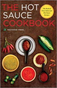Book Cover of The Hot Sauce Cookbook by Rockridge Press