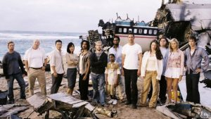 The cast of Lost posing in front of airplane debris.