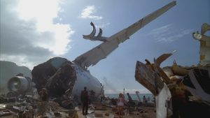 Screen capture from Lost's pilot episode; a crashed plane and debris.