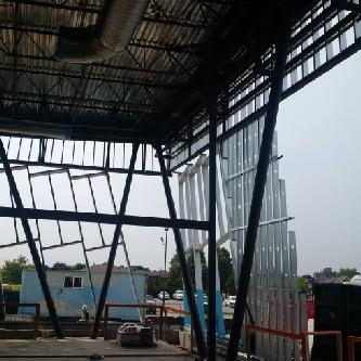 Curtain wall framing is progressing.