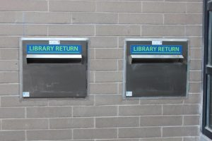 Close-up of exterior book return slots.