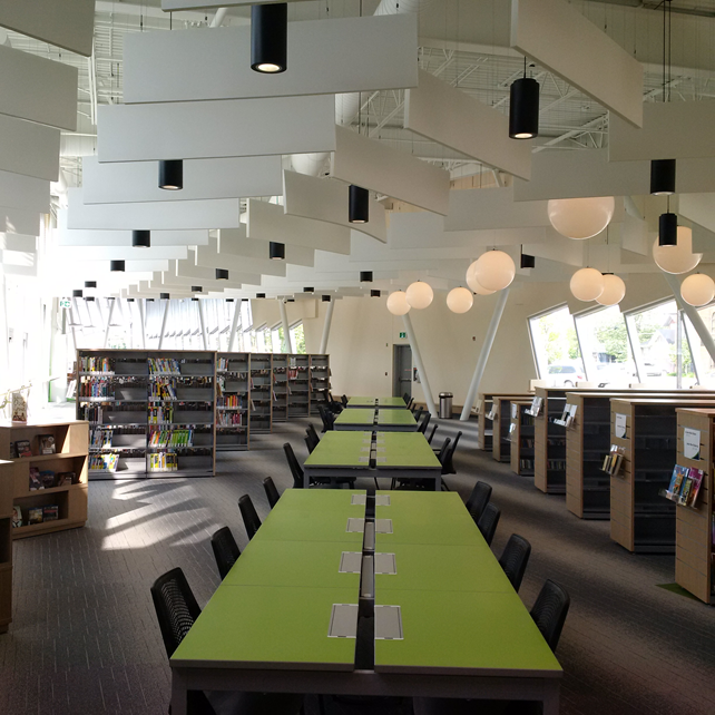 Long green table inside of library