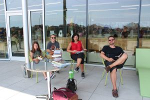 Family reading on Vellore Village Library patio