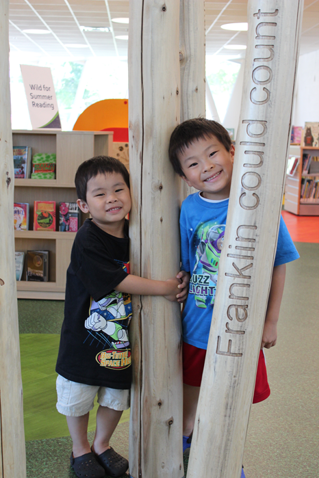 Children are enjoying the trees inside the children's section
