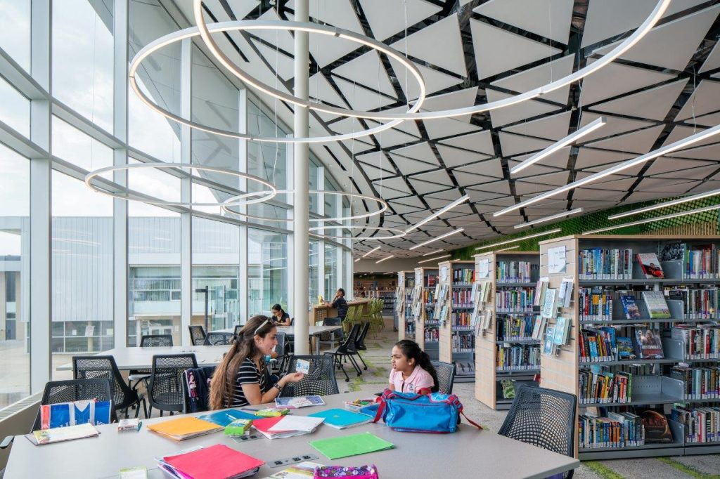 Triangular baffles and circular lighting give Vellore Village Library a feeling of space and airiness.