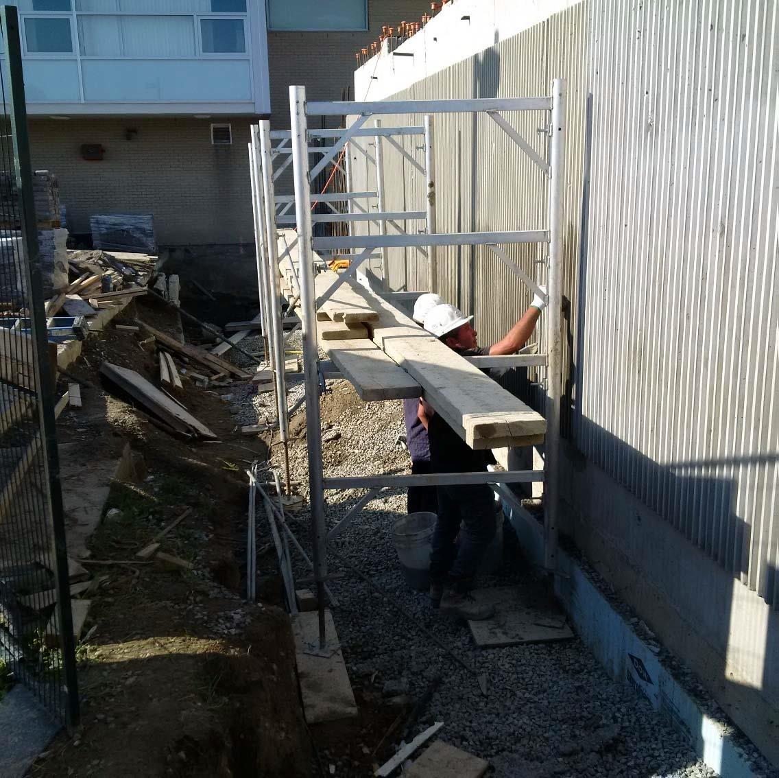 Foundation wall showing fluted concrete.