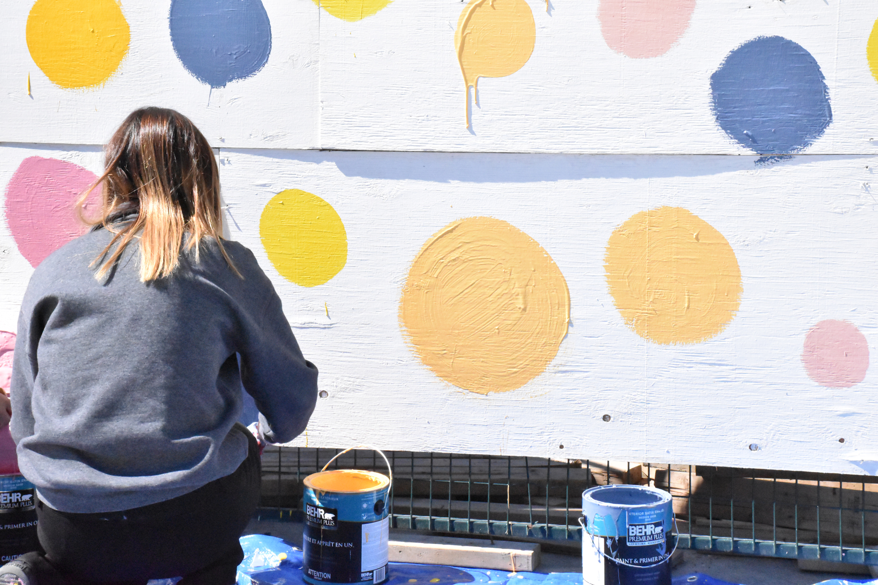 Student painting hoarding fence